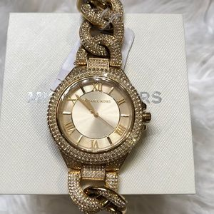 GENTLY USED MICHAEL KORS GOLD WATCH